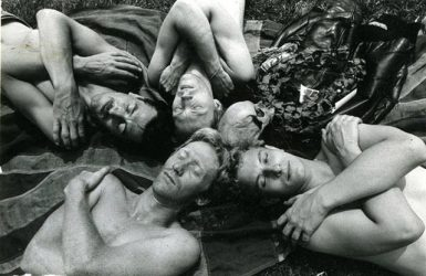 A promotional image for the play Poppies in 1983. 4 men and a skeleton lie together to form the shape of a star.