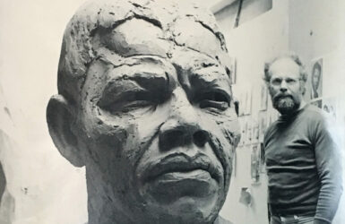 Sculptor Ian Walters with his colossal bust of Nelson Mandela