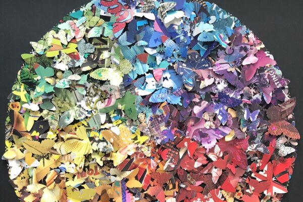 A circle composed of hundreds of multicoloured paper butterflies
