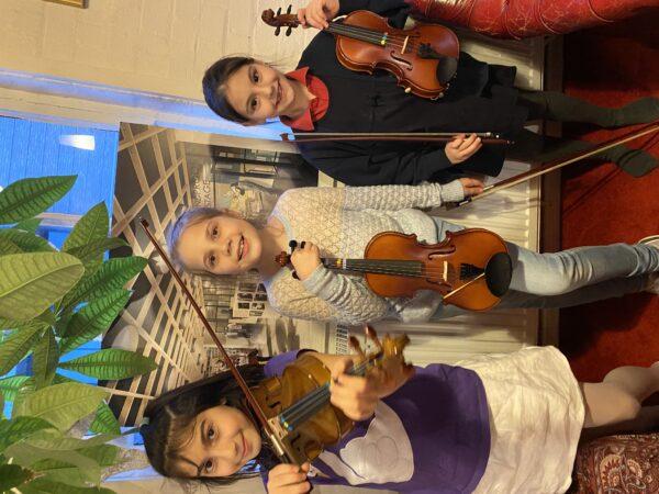 Learn violin at World Heart Beat