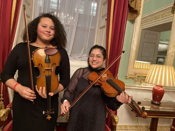 Young violinists in green room before performing at Mansion House